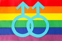 Male gender mars symbol on rainbow flag background. Gay pride, homosexual and lgbt concept - male gender symbol on rainbow flag background royalty free stock images