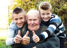 Male generations thumbs up stock images