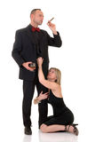Male gigolo, woman at his feet Royalty Free Stock Images