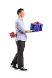 Male giving a large gift and hiding a small one Royalty Free Stock Images