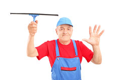 Male glass cleaner in uniform holding a cleaning equipment Royalty Free Stock Photography