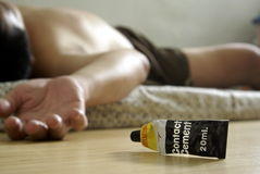 Male glue sniffer unconscious Stock Photography