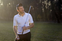 Male golf player. Is playing outdoors on playing field Royalty Free Stock Image