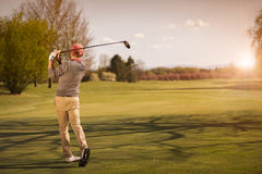 Male golf player at sunset. royalty free stock images