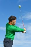 Male Golf Swing on a beautiful day Stock Photos