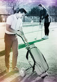 Male golfer is choosing right brassy Royalty Free Stock Photos