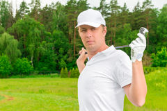 Male golfer with a golf club Stock Image