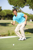 Male Golfer On Golf Course. Putting On Green Stock Photography