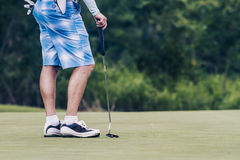 Male golfer on golfcourse in Thailand Stock Images