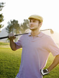 Male Golfer Holding Club On Golf Course Royalty Free Stock Photos