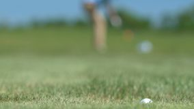 Male golfer making shot and missing hole, feeling angry and nervous, loser. Stock footage stock footage
