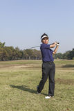 Male golfer player teeing off golf ball from tee box Royalty Free Stock Images