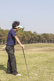 Male golfer player teeing off golf ball from tee box Stock Photography