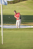 Male Golfer Playing Bunker Shot. On Golf Course Stock Photography