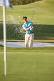 Male Golfer Playing Bunker Shot. On Golf Course Stock Photos