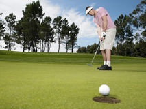 Male Golfer Playing Golf Stock Image