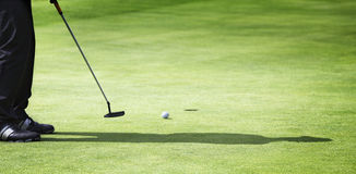 Male golfer putting. Stock Image
