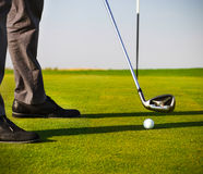 Male golfer putting, focus on golf ball Stock Photography