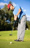 Male golfer in putting green Royalty Free Stock Photos