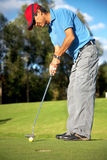 Male golfer in putting green Stock Images