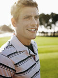 Male Golfer Smiling On Golf Course Royalty Free Stock Photos
