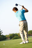 Male Golfer Teeing Off. On Golf Course stock photo