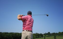 Male Golfer Tees Off Royalty Free Stock Photo