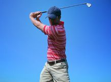 Male Golfer Tees Off Stock Image