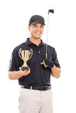 Male golfing champion holding a gold cup. Isolated on white background royalty free stock photo