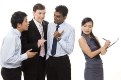 Male Gossips 1. Three businessmen talk about a female colleague behind her back Stock Photography