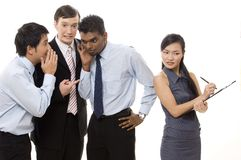 Male Gossips 2. Three businessmen whisper about a female colleague behind her back Stock Photos