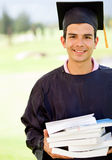Male graduate with books Stock Photo
