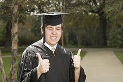 Male graduate giving thumbs up Royalty Free Stock Images
