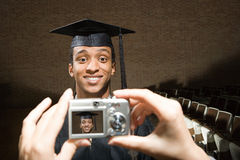 Male graduate having his photograph taken Royalty Free Stock Photography