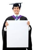 Male graduate holding a ad Royalty Free Stock Photo