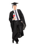 Male graduate holding a diploma Royalty Free Stock Photo