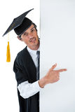Male graduate student behind a panel and pointing with finger Stock Photography