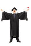 Male graduate student holding a diploma and throwing his hands i Stock Image