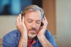 Male graphic designer listening music on headphones Stock Photos