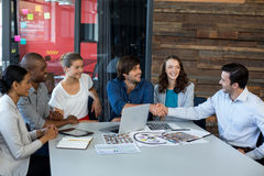 Male graphic designer shaking hands with his colleague Royalty Free Stock Images