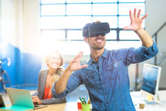 Male graphic designer using the virtual reality headset. At office Stock Images