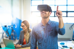Male graphic designer using the virtual reality headset. At office Stock Image