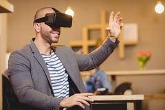 Male graphic designer wearing virtual glasses. In office Stock Photo
