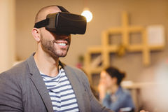 Male graphic designer wearing virtual glasses. In office Stock Photography