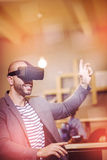 Male graphic designer wearing virtual glasses. In office Royalty Free Stock Photos