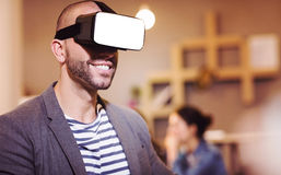 Male graphic designer wearing virtual glasses. In office Stock Photos