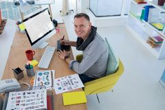 Male graphic designer working at desk. In the office royalty free stock photo
