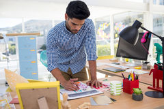 Male graphic designer working at desk. In the office stock photos