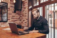 Creative man using digital tablet and stylus pen stock photo