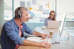 Male graphic designer working while listening music Royalty Free Stock Photography